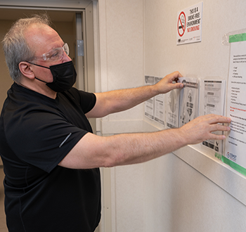 Staff member sharing COVID-19 site safety protocols